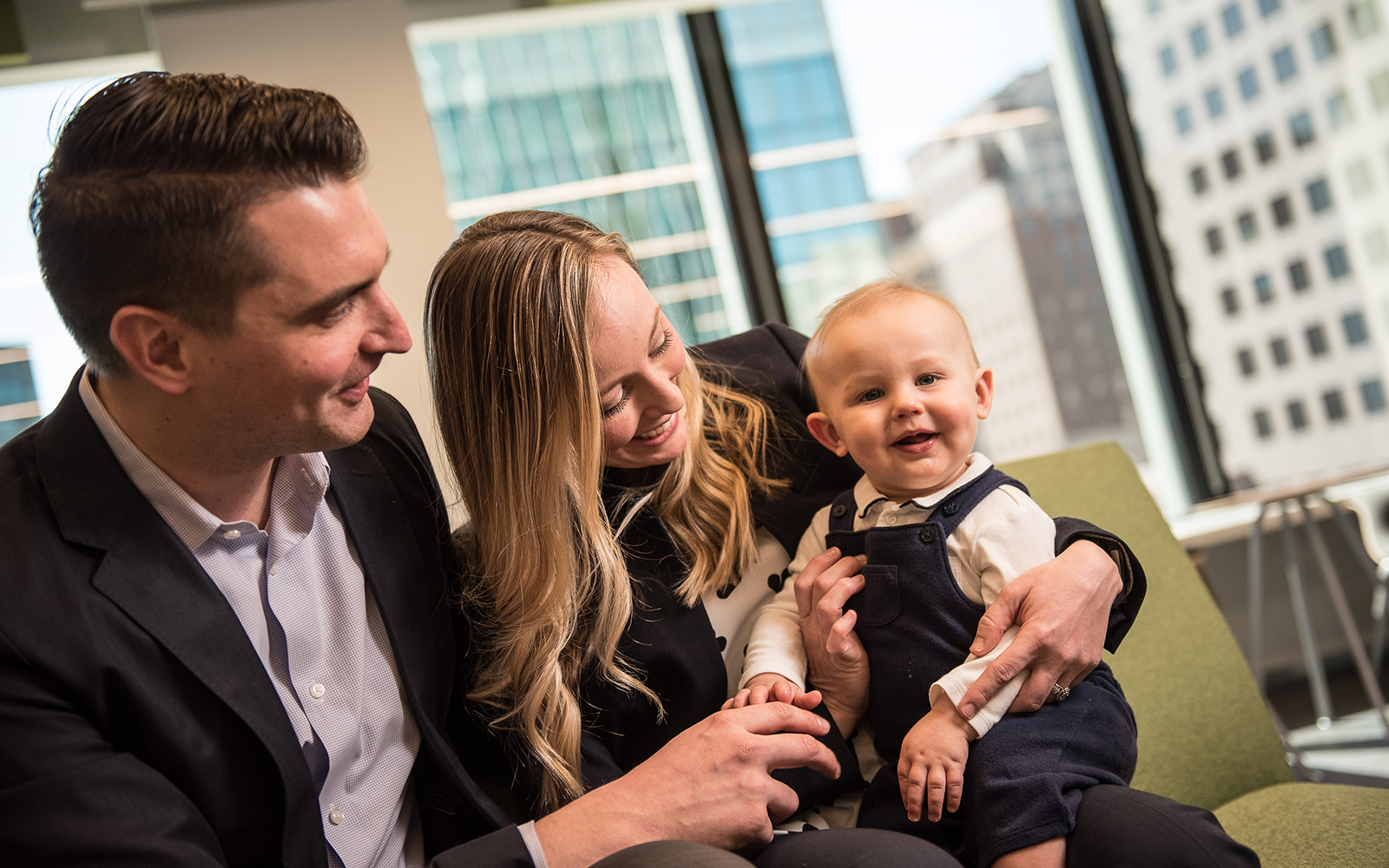 Chris DiGiacomo (left) and his wife Julie Marquis DiGiacomo (right) balanced work, marriage, and childbirth to earn their MBAs through UConn's PMBA program. (Nathan Oldham / UConn School of Business)