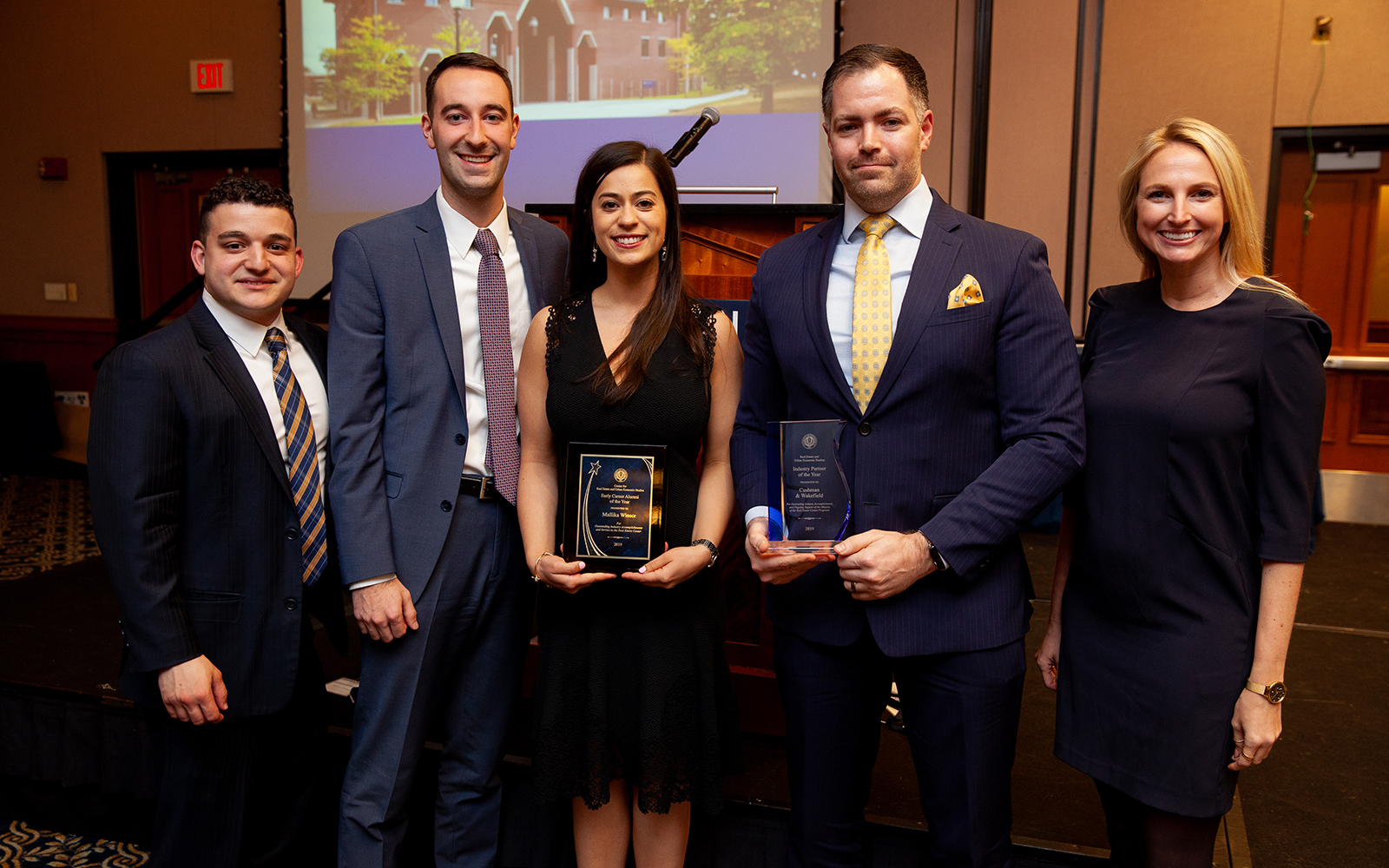 Mallika Winsor, Senior Associate at Cushman & Wakefield, is surrounded by colleagues during the Real Estate Center's annual banquet. (Zack Wussow)