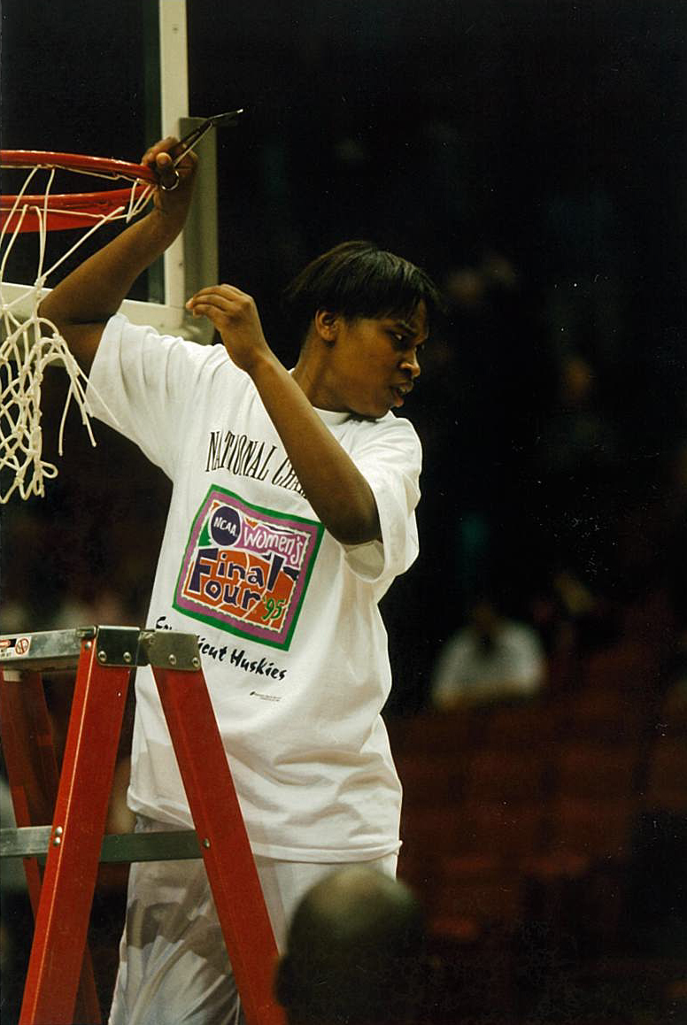 Jamelle Elliott, cutting down the net after the Huskies victory at the 1995 NCAA Championship. (Contributed Photo)