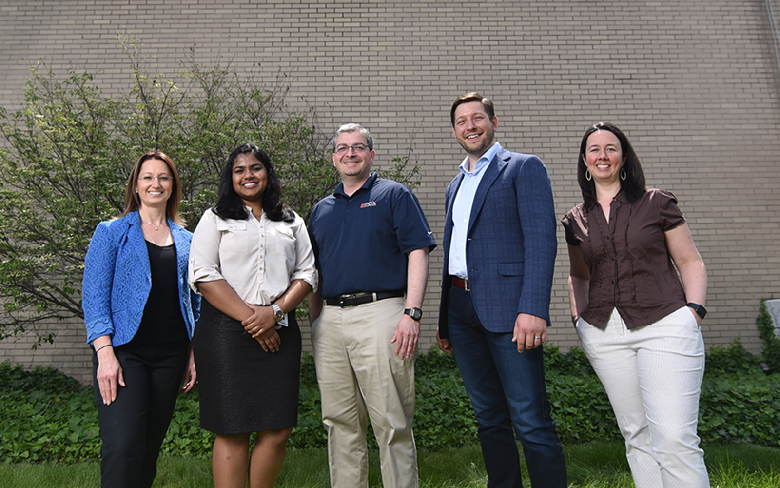 Left to right, professor Anna Radziwillowicz, MSBAPM student Chitra Reddy, PCX general manager and COO Aris Fotos, MBA Student Don Pendagast, and professor Jennifer Eigos. (Nathan Oldham / UConn School of Business)