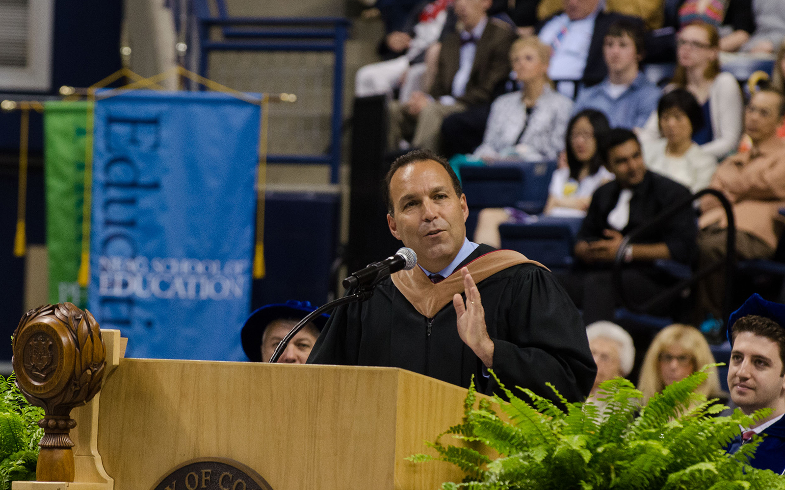 Daniel Toscano '87 (BUS) gives the keynote address at the School of Business Commencement ceremony held at Gampel Pavilion on May 12, 2013. (Ariel Dowski/UConn Photo)