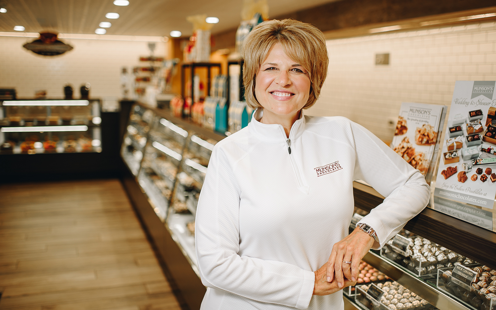 Karen Munson, the president of Munson's Chocolates, in her retail store in Bolton, CT. At this location, Munson's produces 350,000 pounds of chocolate per year. (Nathan Oldham / UConn School of Business)