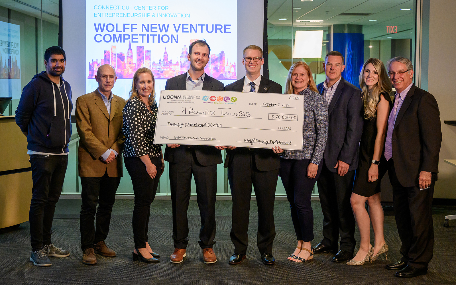 Phoenix Tailings, the group that won the 2019 Wolff New Venture Competition, poses for group photos with the judges. (Evan Olson/UConn Photo)