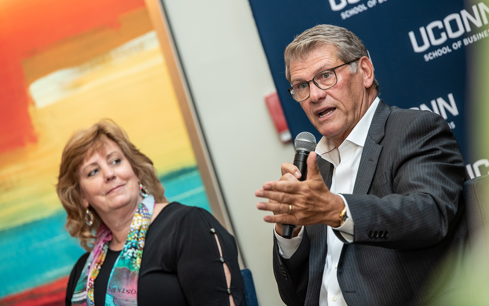 Lucy Gilson (left), Associate Dean of the UConn School of Business and Geno Auriemma (right), Head Coach of UConn Women's Basketball, speak during the first day of the Leadership Conference.  This year's program focused on leading through complexity and uncertainty. (Nathan Oldham / UConn School of Business)