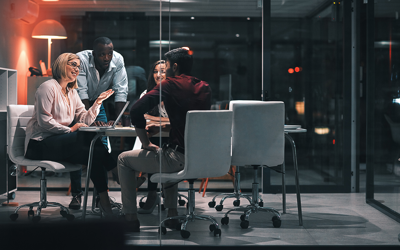Shot of colleagues having a meeting during a late night in a modern office