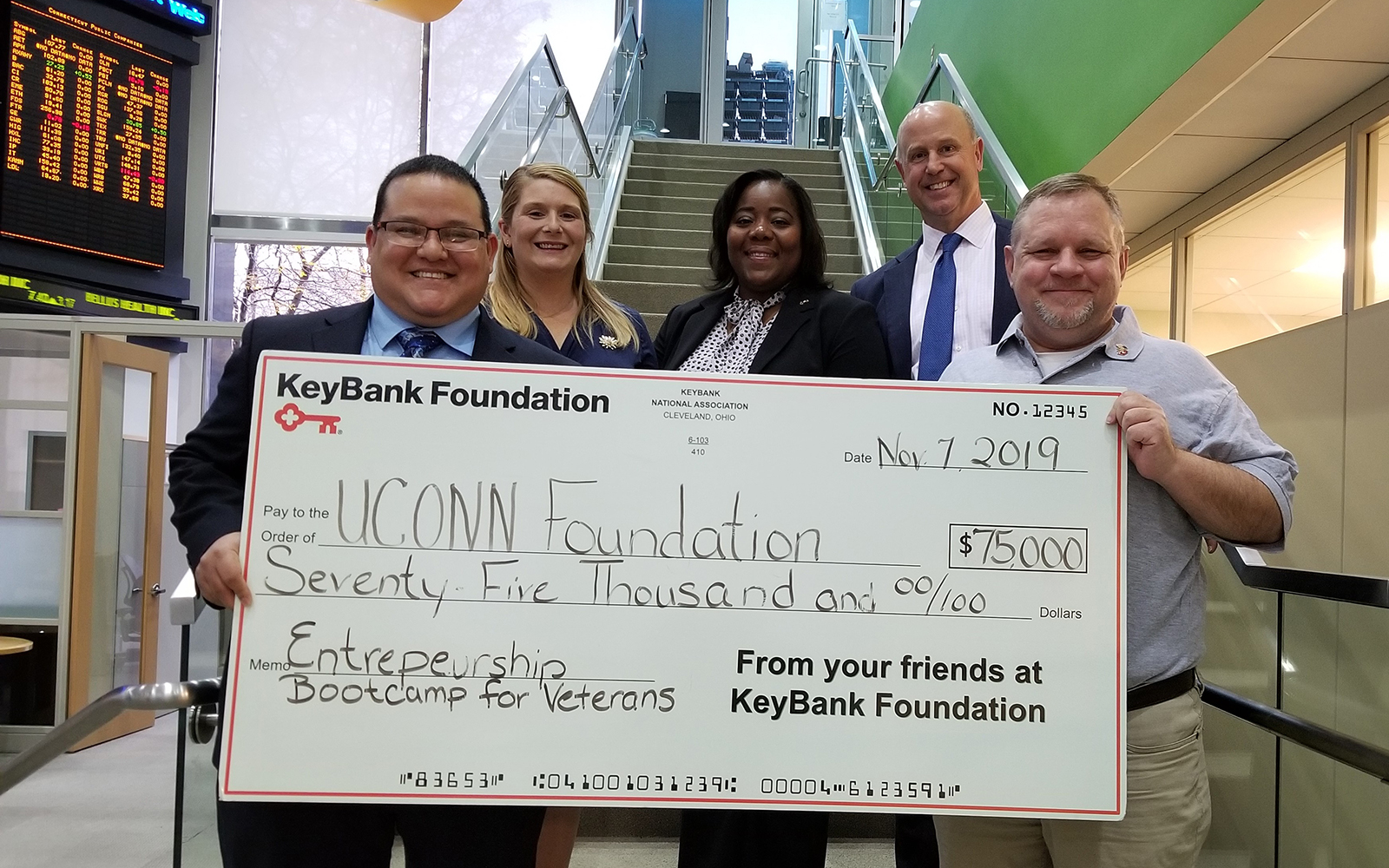 KeyBank has presented a $75,000 grant to the UConn School of Business' Entrepreneurship Bootcamp for Veterans, which helps U.S. military veterans become small business owners. Pictured from left to right are UConn EBV program graduates Jorge and Jessica Rodriguez, KeyBank Corporate Responsibility Officer LaKisha Jordan, KeyBank Market President Jim Barger, and UConn EBV Director Michael Zacchea. (Contributed Photo)