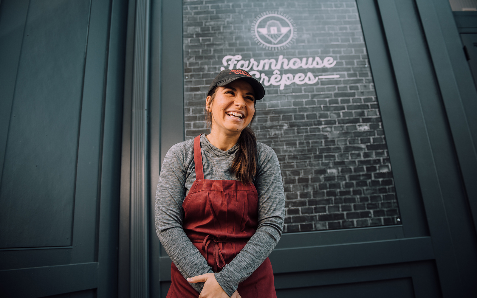 Ashley DeCarlo smiling outside of Farmhouse Crepes
