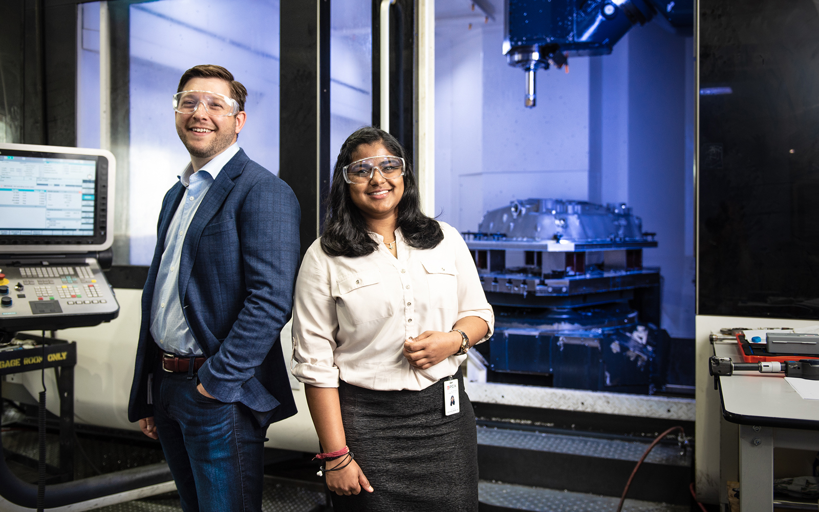 Donald Pendagast and Chitra Reddy pose near industrial equipment.