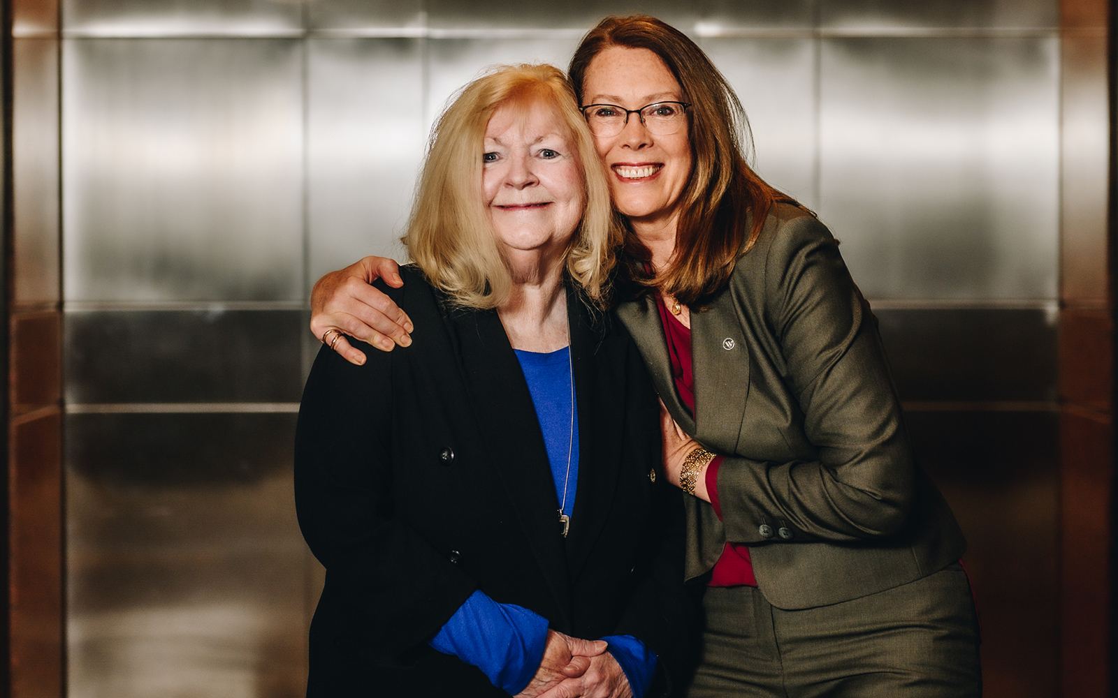 Tracie Borden (left), director  of administration & external affairs at UConn Waterbury, poses with Luria (right). (Nathan Oldham / UConn School of Business)