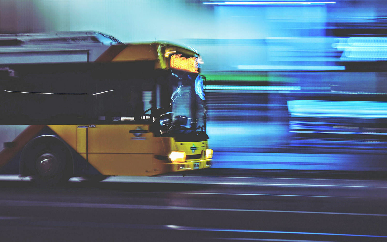 Blurred Motion Of Bus On Road At Night
