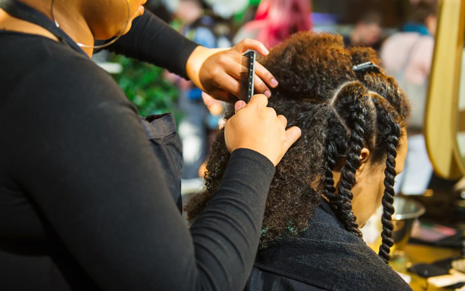 Connecticut recently outlawed workplace discrimination based on hairstyle, which UConn alumni and faculty members say is long overdue, especially for Black and Latino workers (Adobe Stock).