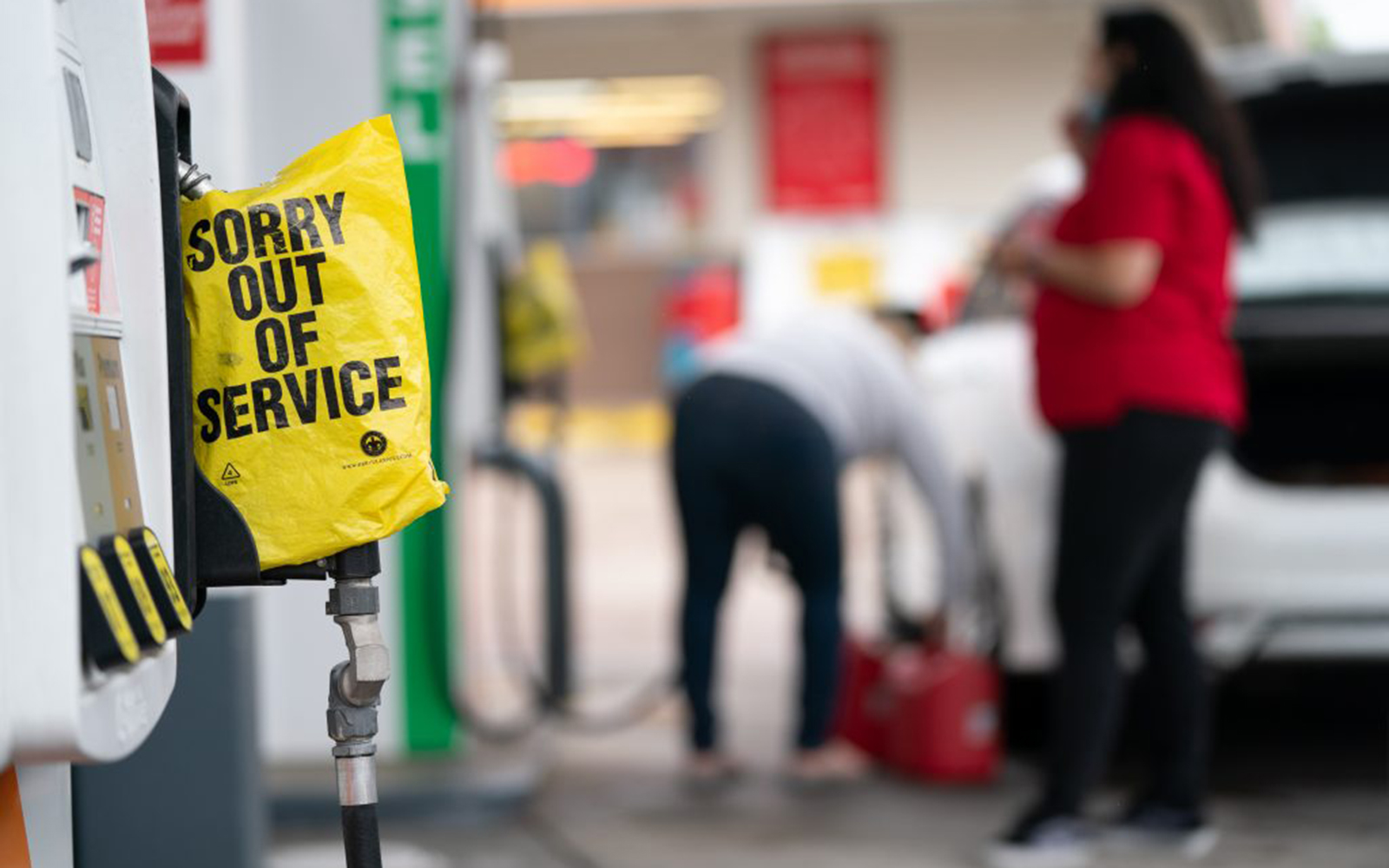 An out of service bag covers a pump handle at a gas station May 12, 2021 in Fayetteville, North Carolina. UConn's Stephen Fitzgerald says the ransomware attack that led to the gas shortage is a harbinger of things to come for multiple industries. (Photo by Sean Rayford/Getty Images)