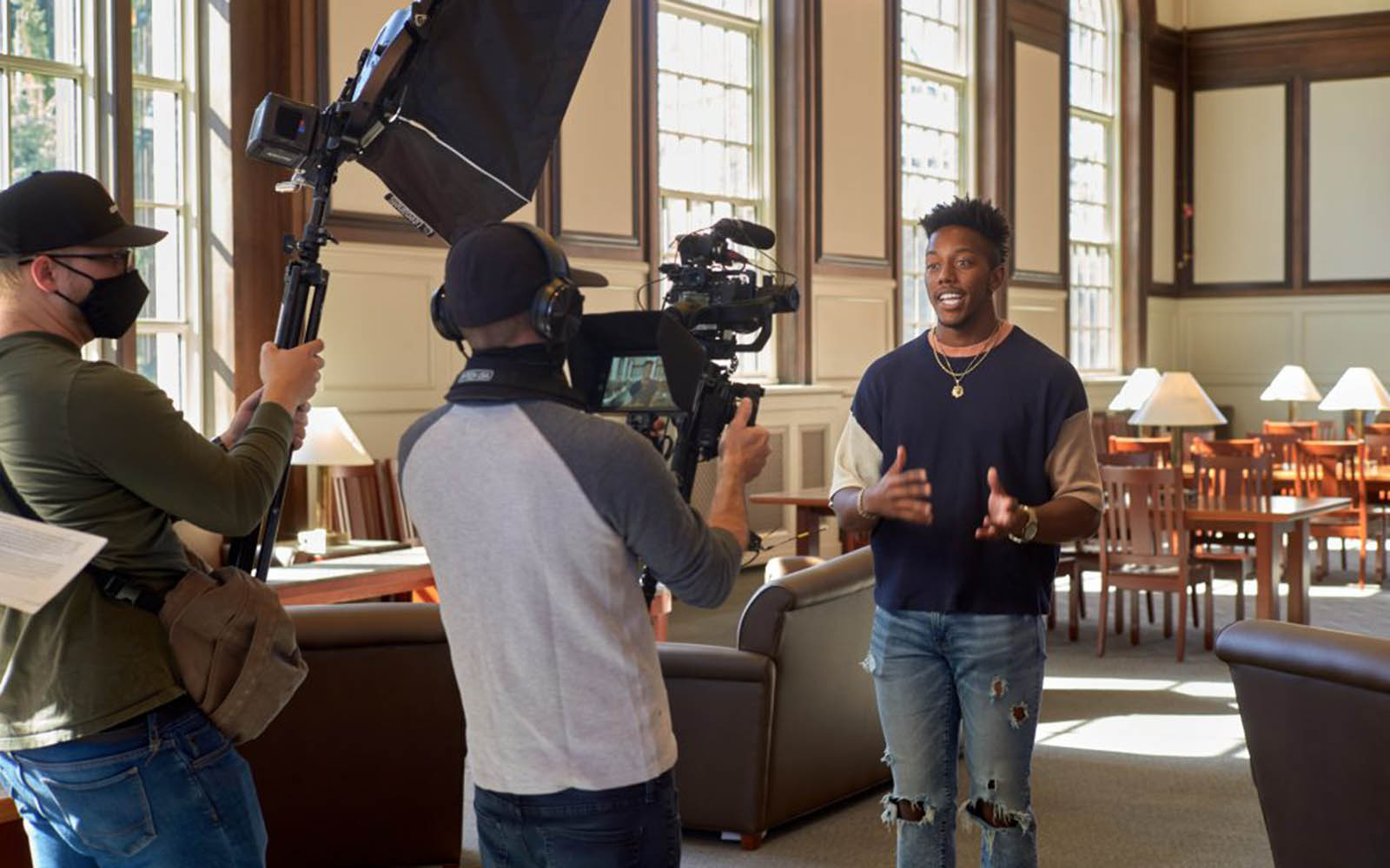 """Shane Young '21 (BUS) is interviewed at the Wilbur Cross North Reading Room for """"The College Tour"""" a television program on Amazon on April 6, 2021. (Peter Morenus/UConn Photo)"""